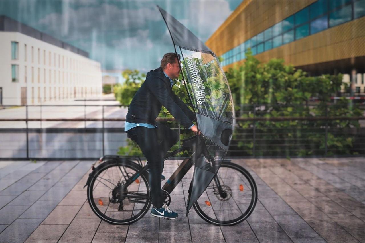 Чехол - зонт с мягким верхом RainRider, предназначен для велосипедистов, чтобы оставаться сухим во время дождя