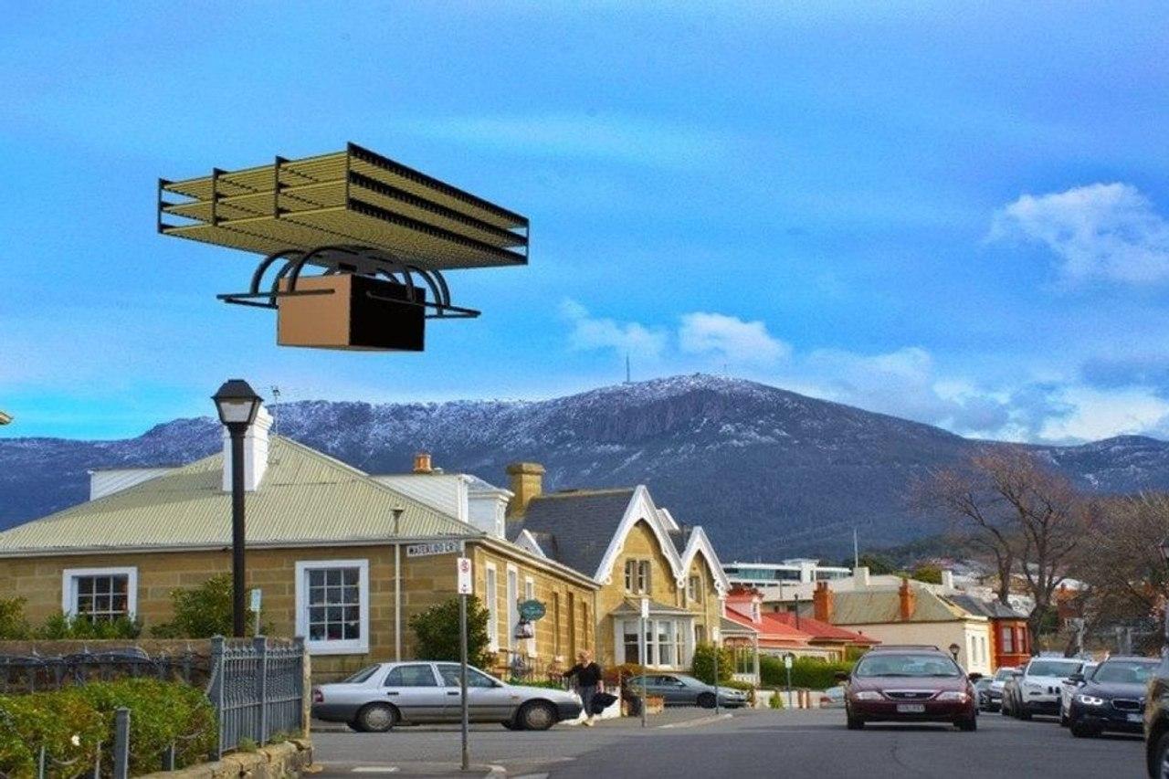 Бесшумный дрон с ионным двигателем вертикального взлета и посадки для доставки грузов по городу