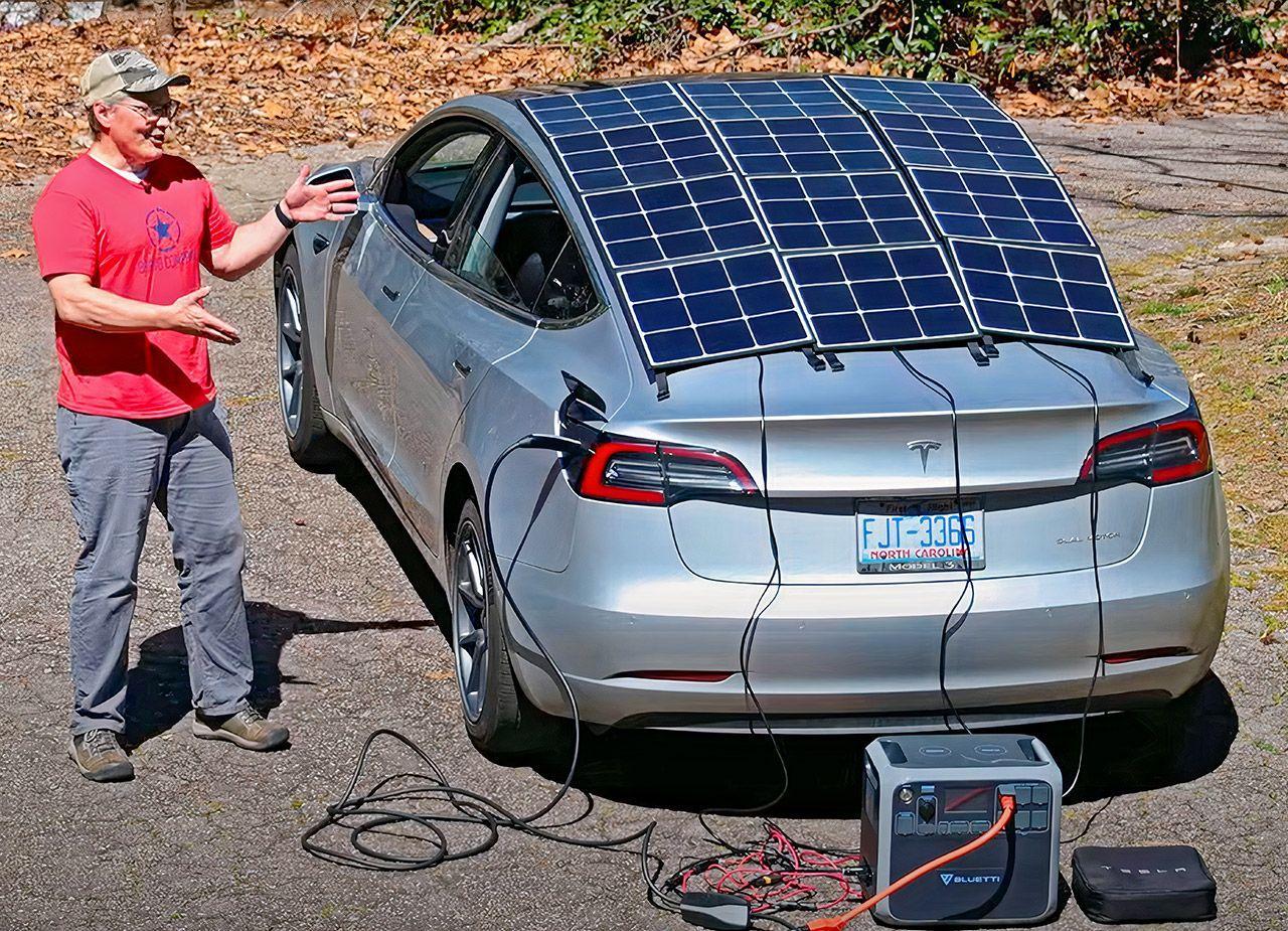 Владелец Tesla Model 3, для автономной зарядки, самостоятельно установил на свой автомобиль солнечную крышу
